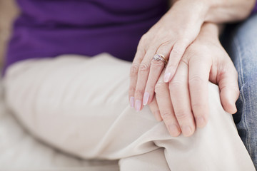 close up of senior couple touching hands
