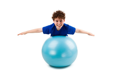 Active boy exercising on white background