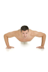 bare-chested man does push-ups