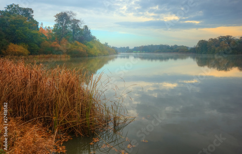Beautiful Autumn Fall lake scene with vibrant reflections