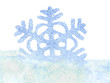 Snowflake in snow. Isolated.