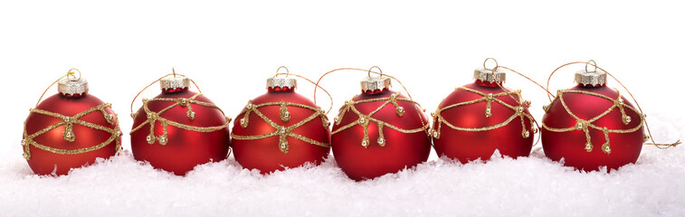 Group of christmas ball in snow. Isolated.