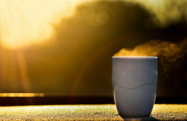 Morning coffee in sun rays