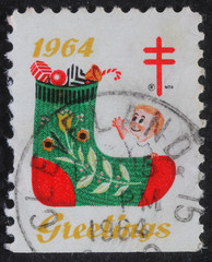 USA - CIRCA 1964: A greeting Christmas stamp