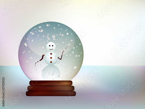 Glass ball with a snowman in a snowy landscape.