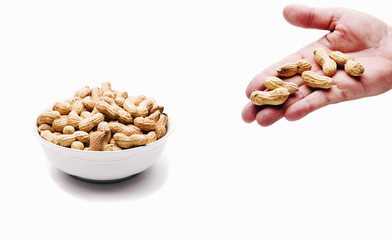 Peanut Bowl and Hand Full of Nuts