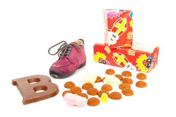 little children's shoe with pepernoten and chocolate letter