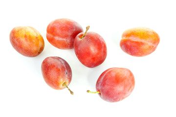 couple of healthy plums over white background