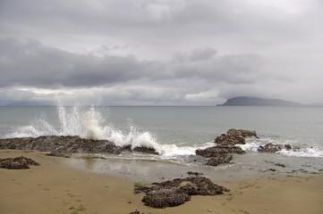 Crashing waves on a Rum beach