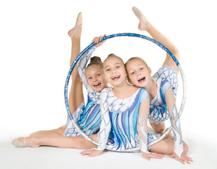 Little beautiful gymnasts with the hoop