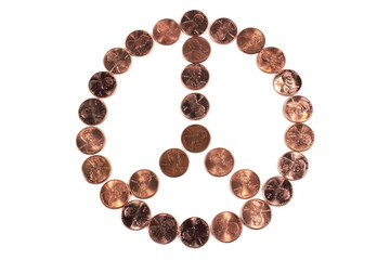 peace symbol made from pennies on white background