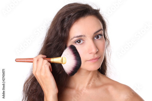 fashion model with professional makeup brush