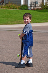 Little boy with skateboard