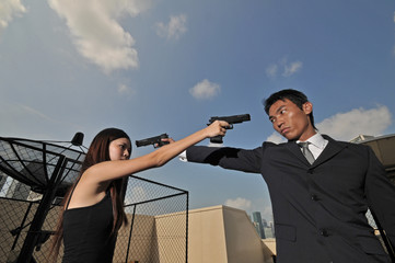 asian chinese couple on roof trying to kill each other
