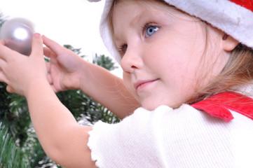 little girl near Christmas tree