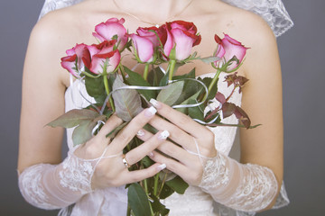Bride holding a red rose