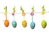 Fototapety Easter eggs hanging on the clothesline isolated on white