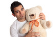 Affectionate man holding bear