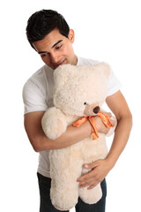 Man hugging a teddy bear
