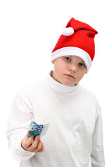 Small boy in Santa's hat with some paper money isolated on white