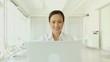 Asian Businesswoman on a Laptop