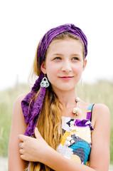 Closeup of model girl on the beach