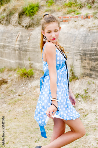 Fashion girl urbex location blue polka dress