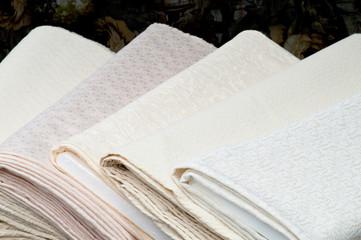 Rolls of white fabric