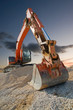 Orange coloured heavy construction digger