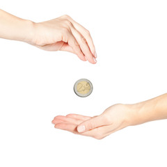 Female hand giving money (coin in motion)