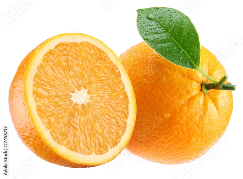 Ripe orange and its half with leaf.