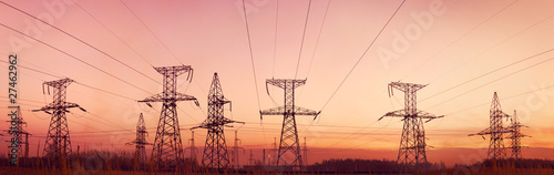 Electricity pylons and lines at dusk. - 27462962