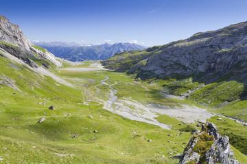 flat green alpine valley