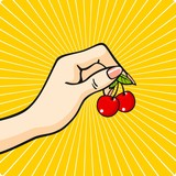 Fototapety Hand with a cherry