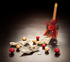 Christmas business decoration: dollars swept with broom on dark