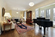 Living room with large piano