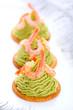 Avocado cream and prawns on crackers