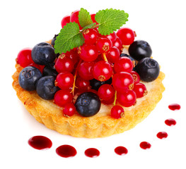Cake with fresh berries and sauce on white isolated background