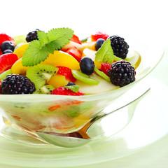 Fresh fruits salad on white background