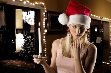 girl santa claus with candle