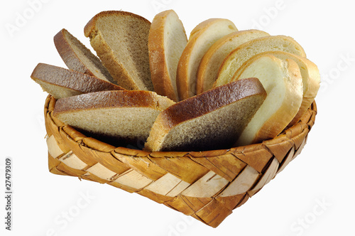 Braided birch-bark bread box with white and brown bread