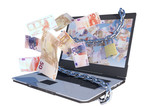 laptop with euro bills flying out screen