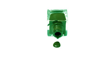 green nail polish bottle with splatters isolated on white backgr