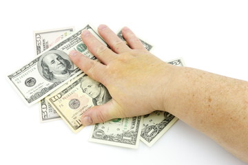Hand and dollars on a white background