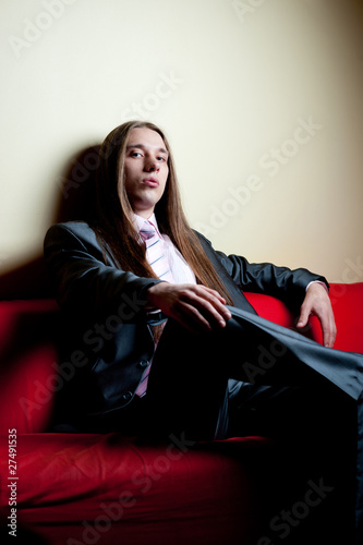 Portrait of longhaired serious man in suit