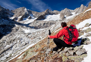 Hiker observing a high mountain panorama