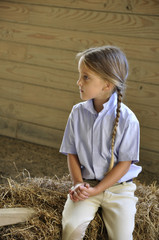 blond hair girl in stable