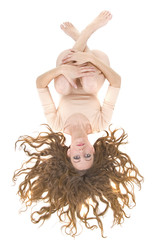 Beautiful woman lying on floor with flowing hair