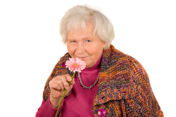 Seniorin mit Blüte