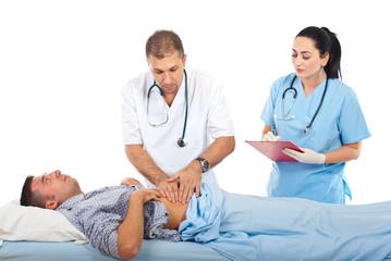 Doctor palpating patient abdomen
